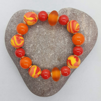 Orange, hot pink and yellow polymer clay bracelet