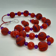 Red and purple necklace and earrings set