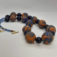 Stylish burnt orange sparkly blue polymer clay necklace