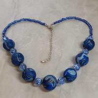 Handmade polymer clay and glass necklace in shades of blue