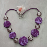 Stunning handmade polymer clay disc shaped necklace