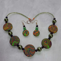 Stunning polymer clay disc shaped necklace and earrings set