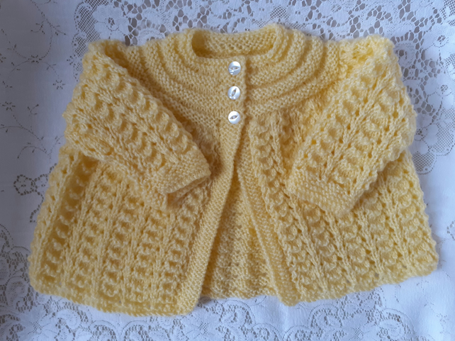 Yellow hand knitted matinee jacket or cardigan for baby birth to 3 months.