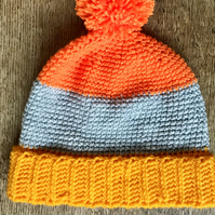 Age 5-7 colour block hat in orange and yellow  Pom-Pom, bobble, winter hat