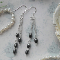 Hematite double drop earrings with Hematite ovals and silver beads.