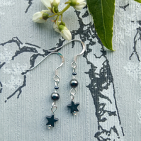 Hematite and silver earrings with stars.