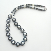 Hematite and Mother of Pearl necklace. Art Deco style. Silver clasp.