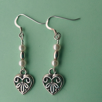 Celtic design heart earrings with little pearl beads.