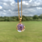 Gold pendant resin necklace with purple flowers