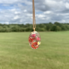 Gold pendant resin necklace with red flowers