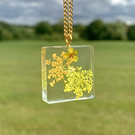 Gold pendant resin necklace with yellow and orange flowers