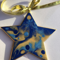Christmas decoration, abstract, star, ornament , shimmering blue, bright gold