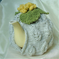 Primrose topped tea cosy - hand knitted - to fit a large standard size teapot