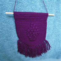Crochet wall hanging with tassels - plum