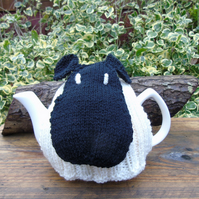 Knitted tea cosy, hand knitted with a sheep face large standard teapot size