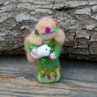 Needle felt figure, Spring holding a lamb - daffodils and primroses on her dress