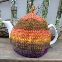 Tea cosy - hand knitted in a sunset colours wool blend chunky yarn