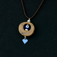 Wood and bead pendant necklace. Handcrafted pendant necklace, wood and enamel.