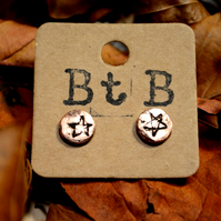 Rustic copper star stud earrings.