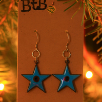 Turquoise enamel star drop earrings.
