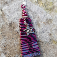 Wire wrapped mauve and pink tree and star design pendant necklace.