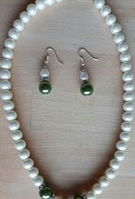 White pearl necklace with green pearls