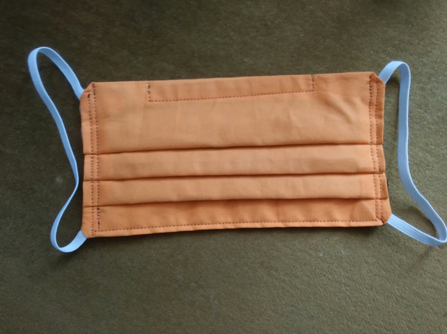 Reusable cotton face mask with pocket for filter and aluminium nose bridge.