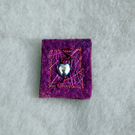 Hand made textile brooch with heart bead