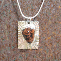 Sterling silver rectangular pendant with red stone.