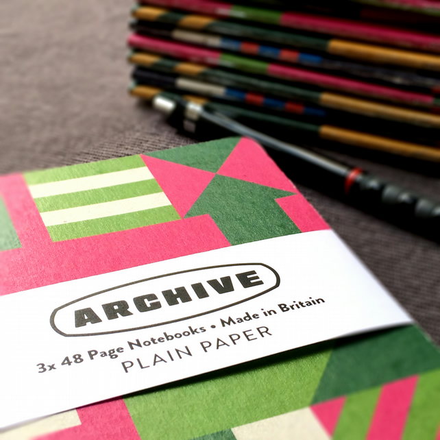 Pack of three, plain paper A6 pocket notebooks with graphic pattern cover.