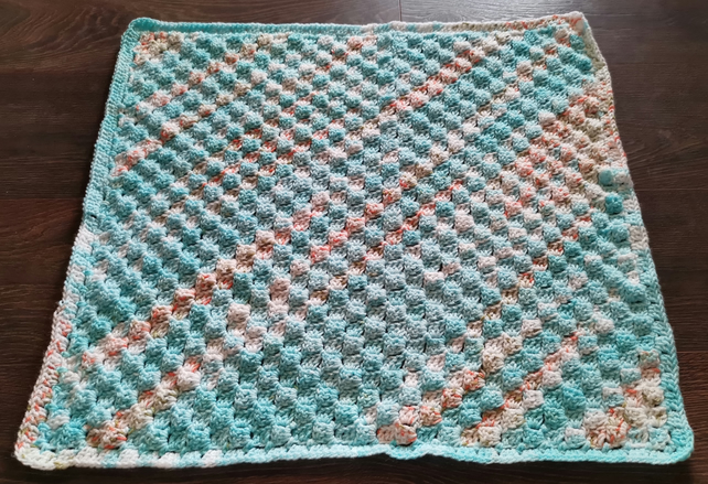 multi-coloured baby blanket