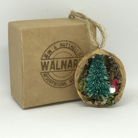Santa with fir tree in half walnut shell hanging decoration