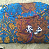 A padded IPad or Tablet Case in Vintage and Designer Label Fabric