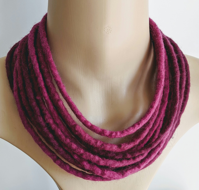 Felted cord necklace in shades of deep pink purple