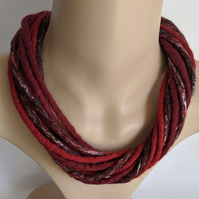 The Twist: felted cord necklace in shades of red