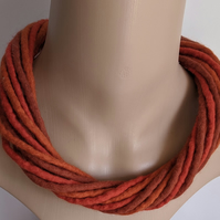 The Twist: felted cord necklace in shades of orange