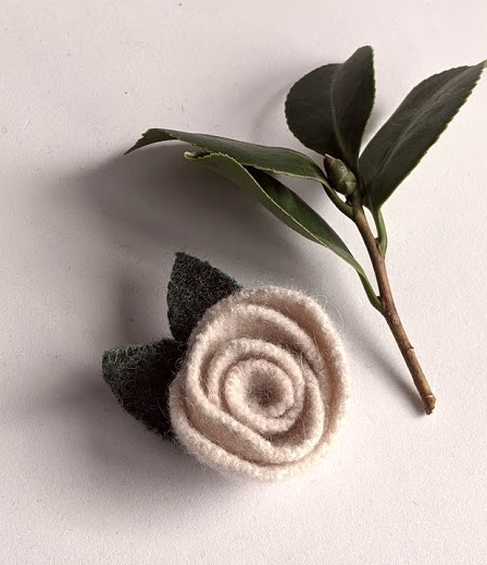 Pearl coloured rose brooch: upcycled wool felt