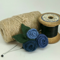 Small felted roses brooch in shades of denim blue