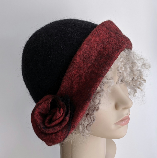 Black felted wool cloche hat with deep red brim