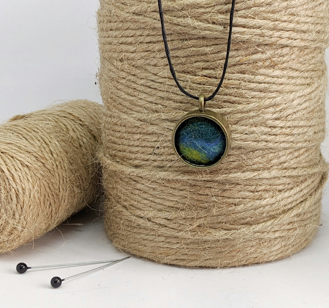 Felted pendant - blues and greens in bronze bezel