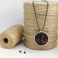 Felted pendant - black and red abstract in silver bezel