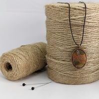 Felted pendant - autumnal shades in copper bezel