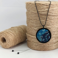 Felted pendant - blues in black bezel