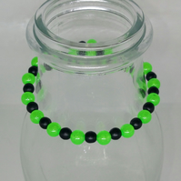 Glow in the dark stretch cord bracelet .UV glow
