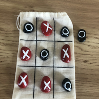 Traditional noughts and crosses painted rocks game