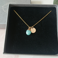 Jade pendant and gold initial disc necklace
