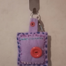Purple felt keyring with sequins and red buttons
