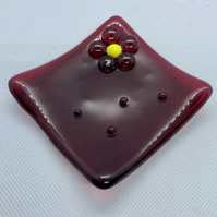 Fused cranberry coloured glass trinket dish with flower decoration