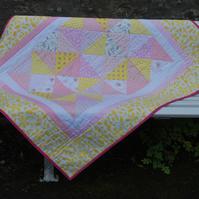 Pink and Yellow Patchwork Quilt