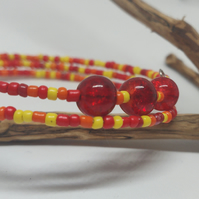 Red to yellow beaded wire bracelet